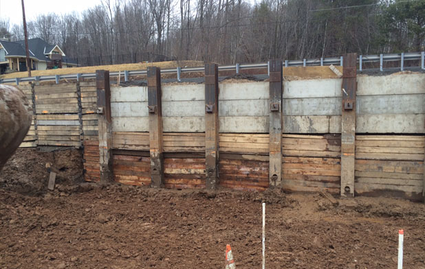 WOODEN SHEET PILE AT SITE